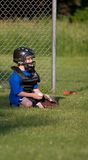 Play Ball. Young boy playing little league Stock Images