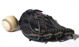 Play Ball. Black leather baseball glove and baseball Stock Photo