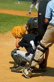 Play Ball - Catcher. Baseball catcher with umpire behind him during a little league game Royalty Free Stock Image