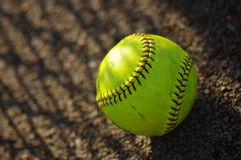 Play ball. Yellow softball waiting for the game Royalty Free Stock Photos