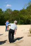 Men playing petanque. Men throwing balls in game of petanque royalty free stock photography