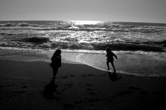 At Play on the Beach. Image of 2 children at play on the beach Royalty Free Stock Image