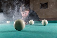 Play billiards. cue and billiard balls. hammer the ball into the hole royalty free stock image