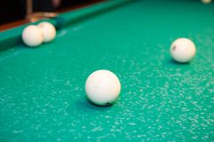 Billiard balls on the table. Play billiards on the table stock photos