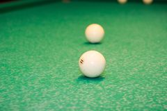 Billiard balls on the table. Play billiards on the table stock photography