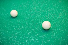 Billiard balls on the table. Play billiards on the table royalty free stock photo