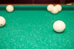 Billiard balls on the table. Play billiards on the table royalty free stock photos