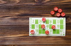 Play bingo on wooden table. Copy space. top view Royalty Free Stock Images