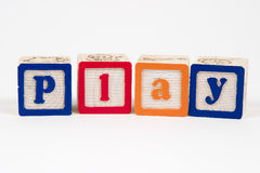 Play in blocks. Play spelled out in childs blocks stock photos