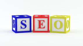 Play blocks spelling SEO Stock Photos