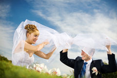 Play of bride and groom Stock Images