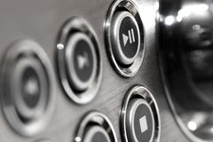 Play button. Close up of music system buttons in silver colour with play pause and stop buttons in focus royalty free stock photos