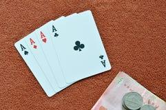Play card showdown ace and money on table Stock Photos