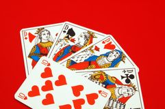 Play cards. On a red table Royalty Free Stock Photography