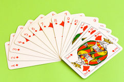 Play cards. All the diamonds - caros - isolated on green background. Stock Photos