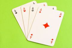 Play cards isolated on green background. Stock Images