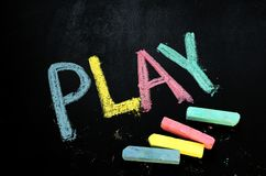 Play on chalkboard royalty free stock image