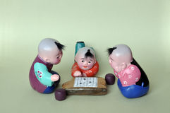 Play chess clay figurine. Tianjin, China's traditional crafts clay figurines Royalty Free Stock Photo