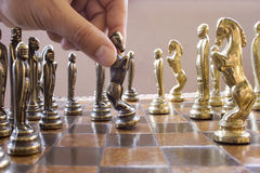 Play chess. Playing chess with a hand which move an horse Stock Photo
