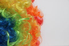 The play of colors. Color circus wig in the background Royalty Free Stock Photography