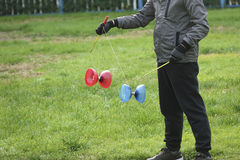 Play diabolo. A person is playing colored plastic diabolo Royalty Free Stock Photos