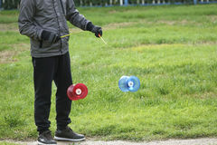 Play diabolo. A person is playing colored plastic diabolo Royalty Free Stock Image
