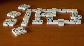 Play Dominoes on a wooden background. Gamble. royalty free stock photo