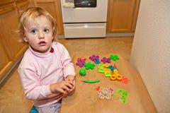 Play-dough. Cute little baby girl having fun with play-dough Stock Photos
