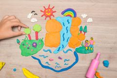 Play dough and Molding clay. Kid`s playing and creating toys from play dough and Molding clay Stock Photo
