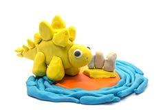 Play dough Stegosaurus on white background.  Stock Photo
