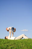 Play with father 3. Young boy play with father. Green grass. Blue sky. 3 Stock Images