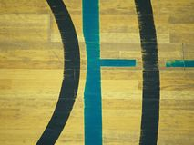 Play field markings on the floor in the gym. Worn out wooden floor in sporting hall. Stock Photo