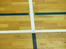 Play field markings on the floor in the gym. Worn out wooden floor in sporting hall. Royalty Free Stock Image