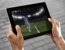 Play FIFA football on Apple Ipad2. A man outdoors play in the game FIFA football on Apple Ipad2 Stock Images