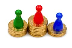 Play figures on coins Royalty Free Stock Photography