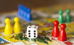 Play figures. Colorful play figures with dice on board Royalty Free Stock Image