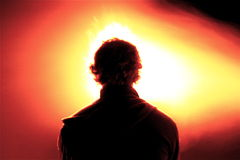 Play with fire. A man in the night who play a light game Stock Image