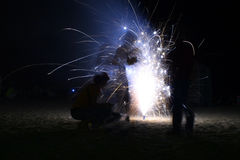 Play with fire. Three boys playing with fireworks Royalty Free Stock Photo