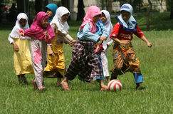 Play football. Islamic school students play football with gloves clothing in the city of Solo, Central Java, Indonesia Stock Photography