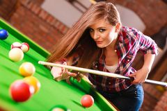 Young woman having fun with billiard. Play and fun concept. Young happy girl having fun with billiard. Smiling fashionable woman playing spending time on Royalty Free Stock Photos