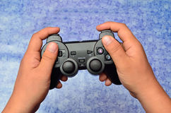 Play game with a joystick Royalty Free Stock Photo