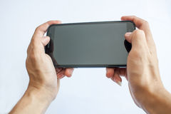 Play gamer on smartphone. Play of gamer on smartphone Stock Photos