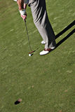 Play Golf. Golfer is hitting the golf ball to the hole royalty free stock photos