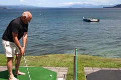 Play Golf on Lake Taupo in New Zealand Stock Photo