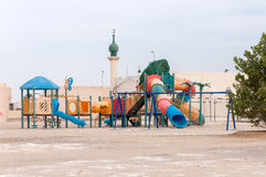 Play ground and mosque in Muqshin, Dhofar (Oman) Stock Images