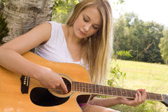 Play with the guitar Royalty Free Stock Images