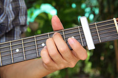 Play guitar with capo Royalty Free Stock Image