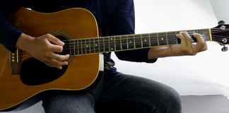 Play a guitar chord Csus4 Royalty Free Stock Photography