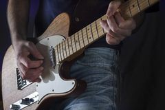Play the guitar Royalty Free Stock Image