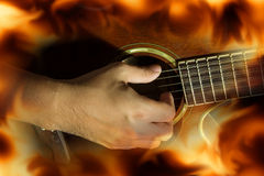 Play guitar with fire flame screen. Royalty Free Stock Photos